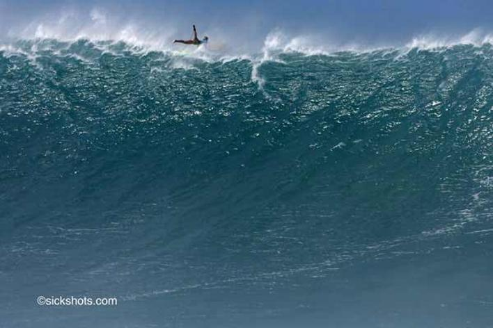 Shot of Jam Star off the wall of a giant wave.  Photo by sickshots.com